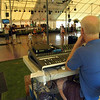 A sound technician at The Great Newtown Reunion event held on Saturday, July 27, seated at a control board in the main tent listened as a band performed. (Gorosko photo)