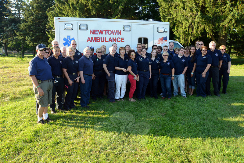 Newtown Volunteer Ambulance Corps members attended Monday evening's groundbreaking. (Bobowick photo)