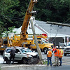 An SUV traveling westward on Berkshire Road (Route 34), near its intersection with Pole Bridge Road, went off the right side of the street midday on Monday, July 29, damaging utility poles and lines. The accident resulted in isolated power outages in the area and the closure of a section of Berkshire Road while repairs were underway. (Gorosko photo)