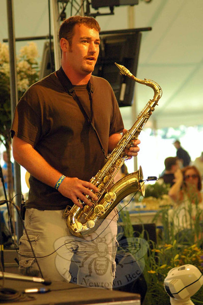 A saxophonist waits to hit his notes during a song performed by one of the many bands which played at the Great Newtown Reunion on Saturday. (Gorosko photo)