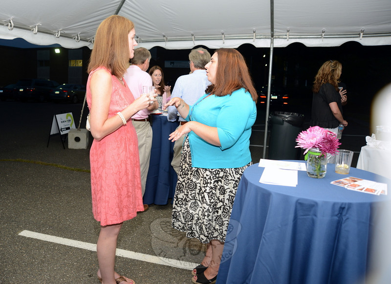 EverWonder Museum supporter Penny Avari, left, and board member Rebekah Harriman-Stites talk during the museum open house Saturday evening, August 24.  (Bobowick photo)