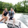 Leaps of Faith volunteer Meg Pettit rides back to the dock with ski clinic participant Avi Golden.  (Bobowick photo)