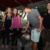Siblings Lauren, Olivia and James Belden, center, crowded around Mellow with handler Jaceson Cole, right.   (Bobowick photo)
