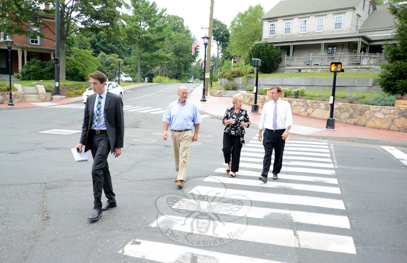 Senator Chris Murphy, right, crosses Washington Avenue with First Selectman Pat Llodra and Sandy Hook Organization for Prosperity Vice President Joe Hemingway, center. Ahead of them is Mr Murphy's assistant Brett Maddux. (Bobowick photo)