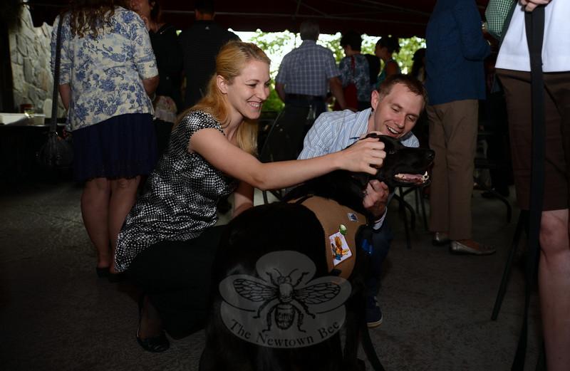 Natalie and James Parker knelt to hug and pet Stryder.   (Bobowick photo)
