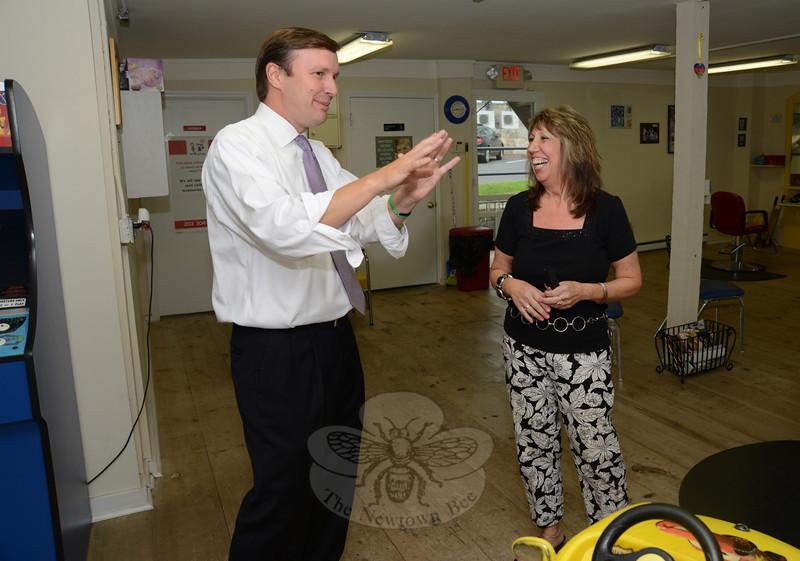 Family Fun Kuts owner Marci Benitez meets briefly with Senator Chris Murphy, left. (Bobowick photo)