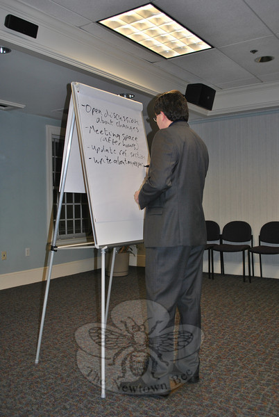 C.H. Booth Library Director Shawn Fields writes down suggestions on a flip chart during the Tuesday evening focus group. (Crevier photo)