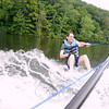 Avi Golden skips across Lake Zoar on a surf ski.  (Bobowick photo)