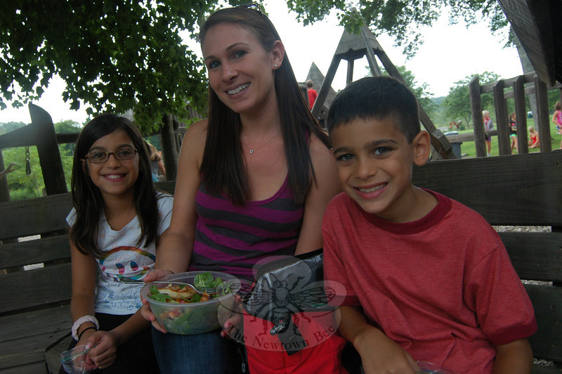 From left, Leena Abdulrahman, Karen Schwartz, and Eamonn Abdulrahman during the family picnic held at Dickinson Park on Monday, August 26, as a gathering for Reed Intermediate School incoming fifth graders, family members, and friends.  (Hallabeck photo)