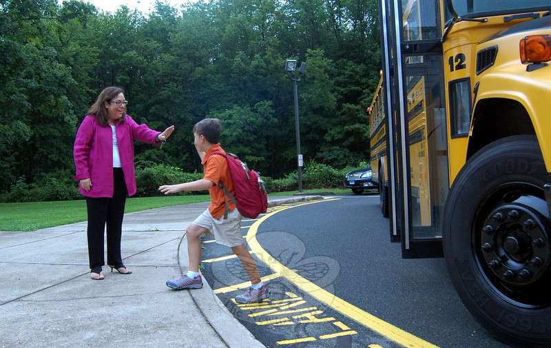 Head O' Meadow Principal Barbara Gasparine welcomed students as they got off their bus on Tuesday, August 27, for the first day of the 2013-14 academic year.  (Hallabeck photo)