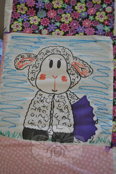 Kaitlyn Gantert drew a lamb on one square that was used in Olivia Engel's quilt.  (Crevier photo)