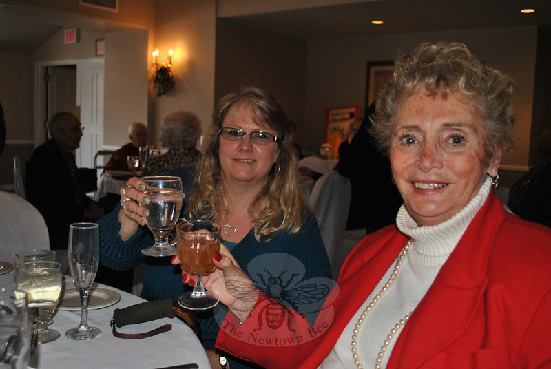Sue Humeston, left, and Gloria Barry raise a glass of cheer at the Newtown Senior Center Holiday Party, Wednesday, December 11. (Crevier photo)
