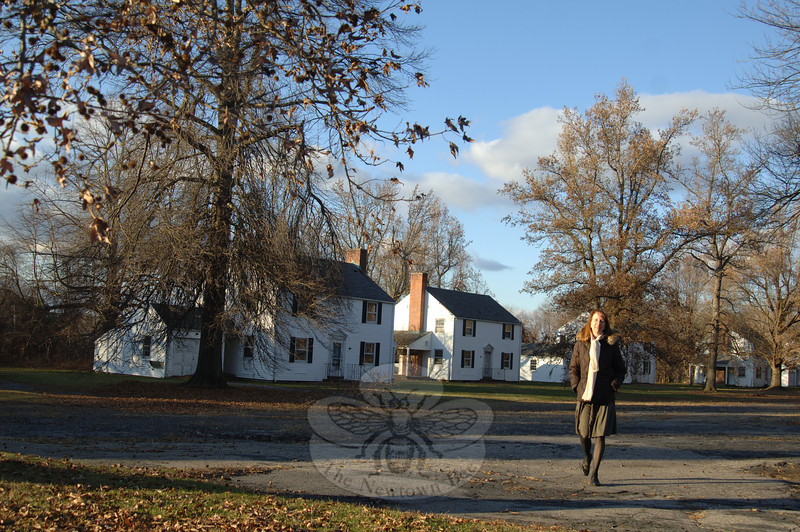 Walking along a secluded drive leading to a group of single-family homes, researcher Andrea Zimmermann imagines what life was like for the Fairfield Hill hospital staff and their families living there. (Bobowick photo)