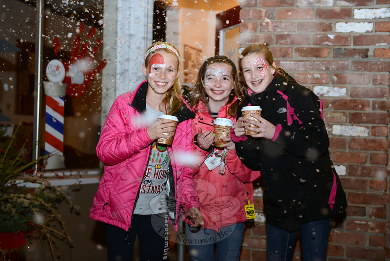 "Sipping cocoa and awash in ""snow"" from a snow machine behind them are, from left, Hanna Groonell, Kaitlyn King, and Colleen Phaneuf. (Bobowick photo)"