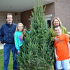 From left, John, Catherine, Heather, and Brian Pendergast stand next to the tree that will decorate their home for the holidays. The Pendergasts were one of many families who purchased a tree from the Newtown Middle School and Reed Intermediate School Interact Clubs on Saturday and Sunday, December 7-8. The Interact Clubs will continue to sell trees recently cut from a local property, the weekend of December 14 and 15, from 10 am to 4 pm. Trees are $40 each, and range in height, up to 16 feet tall. The sale is located at the rear of the Reed Intermediate School, 3 Trades Lane. Follow signs. (Crevier photo)