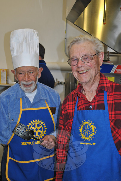 Rotary Club members Dr Bob Grossman, left,  and Skip Roberts, have flipped pancakes at the Annual Pancake Day for more than 50 years. (Crevier photo)