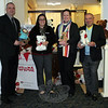 "Newtown resident Howard Lasher, right, made his annual donation to Toys For Tots on December 10. Mr Lasher arrived in the lobby of the Main Street branch of Newtown Savings Bank bearing approximately 150 toys for this year's campaign. Branch Manager Ryan Storms, left, and tellers Alex Berardi, second from left, and Lauren Kochanov were happy to help Mr Lasher arrange the toys. ""[First Selectman] Pat Llodra has suggested doing something to honor those lost on 12/14,"" said Mr Lasher. ""My wife, Jeanette Hubley, and I have decided we wanted to do this,"" he said of his gesture of kindness. ""If you can help those a little less fortunate at this time of the year, it's always a great feeling,"" said the longtime NSB customer. ""This bank has been here for Newtown for generations,"" he continued. ""It's my pleasure to give something back to them. I'm honored to be part of this,"" Mr Lasher added. (Hicks photo)"