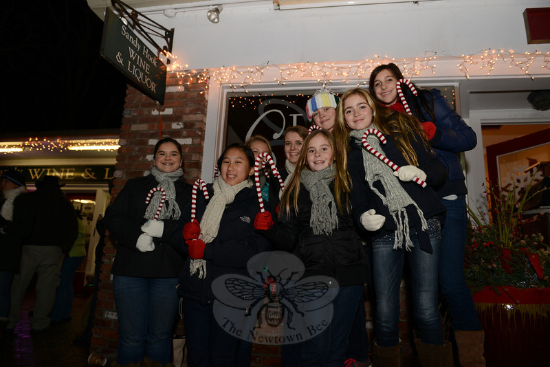 SingOut! CT singers with their candy canes get ready to lead the crowd in carols for the Sandy Hook tree lighting. (Bobowick photo)