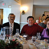 From left, June Hannah, Larry Schneider, Curt Symes, and Marilyn Chernin join in the Newtown Senior Center Holiday Party. Mr Schneider and Mr Symes both are members of the Newtown Commission on Aging. (Crevier photo)