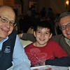 From left, John Sr, John III, and John Boccuzzi, Jr, are all smiles as they finish up their pancake breakfasts. John III also worked as a server at the Rotary Pancake Day. (Crevier photo)