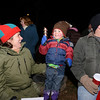 Cady Carroll and Bill Burton are on either side of Jessup Burton, who rings the jungle bells, during the Hawleyville tree lighting. (Bobowick photo)