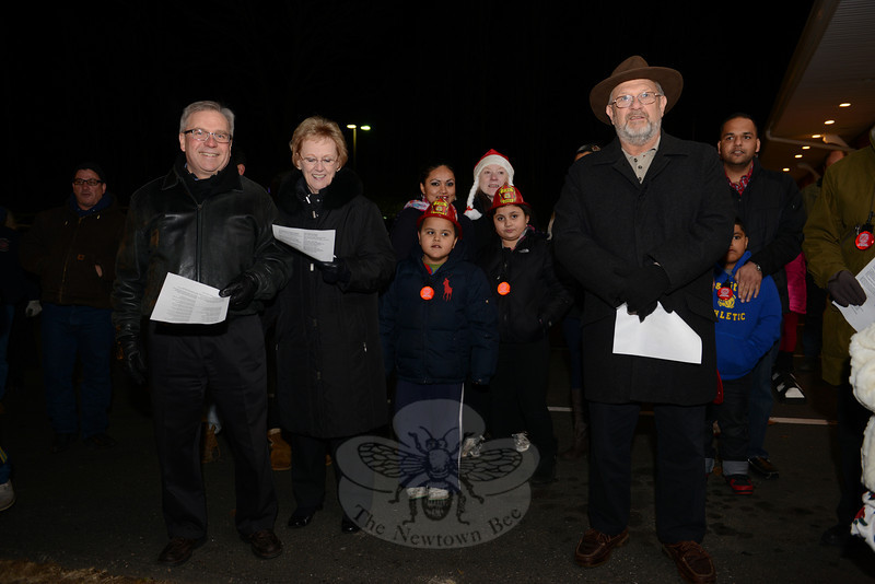 Second from left, First Selectman Pat Llodra carols with guests in Hawleyville. (Bobowick photo)