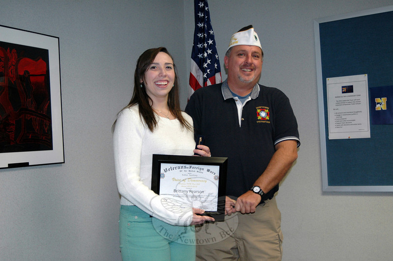 Newtown High School senior Brittany Pearson, left, received a plaque and pen from VFW Post #308 Commander James Rebman on Wednesday, December 3, at NHS. (Hallabeck photo)