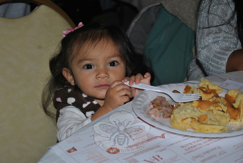 A plate bigger around than her head and an oversized fork do not stop 18-month-old Faith Joy Fawley from enjoying her first Rotary Club Pancake Day. (Crevier photo)