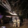 Firefighters from all five of Newtown's companies, as well as a team from Southbury, responded to a fire at 31 The Boulevard shortly after 1 am Sunday, December 8. Newtown police officers arrived just before firefighters, and rescued the two women who live in the house. Both had been overcome by smoke and carbon monoxide. (Hicks photo)