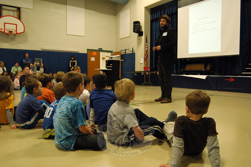 Tim Warren, band member of The Alternate Routes, spoke during a schoolwide assembly at Hawley Elementary School on Friday, December 13. (Hallabeck photo)