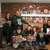 Newtown Lions Club received a donation of 238 toys from Nutmeg Kart Club (NKC). The toys will be used as enticements for those purchasing Great Pootatuck Duck Race tickets in the spring. Proceeds from some of those ticket sales will benefit the club's Sandy Hook Elementary Fund (SHEF). From left is Newtown Lions Club member Bob Schmidt, who serves as chair of The Great Pootatuck Duck Race and administrator of SHEF, with NKC members Erica Canfield, John Latte, Evan Latte, Cole Latte, Kenneth Canfield, Kelsey Danuszar. and Nick Danuszar. (Hicks photo)