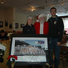 "Santa Claus was on hand on Sunday, December 15, at LeReine's Cuisine, 31 Peck's Lane, where he offered to take photos with children to help raise money for the Hook & Ladder Building Fund. Hook & Ladder members Jill Moller, left, and David White also took their turn standing with Santa for a photo. LeReine's Cuisine owner LeReine Frampton said she plans to hold future events at the restaurant to continue raising money for the fund. She also said the fire company needs as many people as possible to be aware of the need for donations to the fund. ""They're there when we need them. We need to be there for them when they need us,"" she said. Donations for the fund can also be mailed to P. O. Box 3911, Newtown, CT, 06470. (Hallabeck photo)"