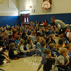 Hawley music teacher Brian Kowalsky lead students during a sing-along school assembly. (Hallabeck photo)
