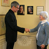 Newtown resident George Duncan, left, met with C.H. Booth Library Interim Director Beryl Harrison on December 16 to formally present a photographic portrait to the library's permanent collection. Mr Duncan has given the library a portrait of 2013 Nobel Prize for Literature winner Alice Munro. The portrait of Ms Munro (on the wall between the two, on the right) was taken in a studio in New York City and appeared in The New York Times Magazine in October 2004, timed to coincide with the publication of her short stories entitled Runaway. An alternate image of the one that appeared in the article, the portrait donated to the library is Mr Duncan's personal favorite from the photo shoot. On the wall to the left of the Munro portrait is a portrait of Marilynne Robinson, who won the 2005 Pulitzer Prize for Fiction. The work was also done by Mr Duncan, who donated it to the library in 2005. Each portrait is printed on archival photographic paper, mounted and laminated to museum-quality standards. Mr Duncan's work has been featured in The New York Times Magazine, New York magazine, and other prominent publications. His fine art portraits are in numerous collections including North Carolina Museum of Art in Raleigh. (Hicks photo)