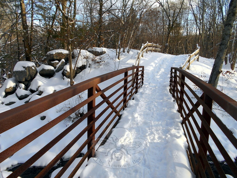 Hikers can pause to overlook a running stream as they cross above it on a foot bridge within Orchard Hill Nature Center. (Bobowick photo)
