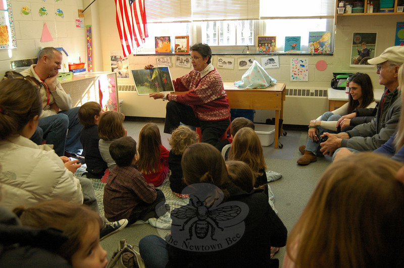 Trinity Day School's Anne Smith read to a group of her 4-year-old students and their parents on Friday, December 13, for a Story Hour. Ms Smith, and other teachers at the day school, read Night Tree by Eve Bunting. The story follows a family as they decorate ever-green trees with food for forest animals near Christmas. (Hallabeck photo)