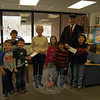 Barbara Lynch of FAITH Food Pantry, fourth from left, and Frank Casey of Marine Corps League and Toys For Tots, second from right, stood with Head O' Meadow students, from left, Joey Terry, James Iaropoli, Grant Ricks, Molly Zatlukal, Dhilan Amin, and Dawson Craft on Friday, December 20, when the students presented both visitors with donations for their organizations. (Hallabeck photo)