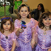 From left, Haley, Melena, and Alicia Ventresca are dressed for the occasion at the Royal Party on Monday. (Crevier photo)