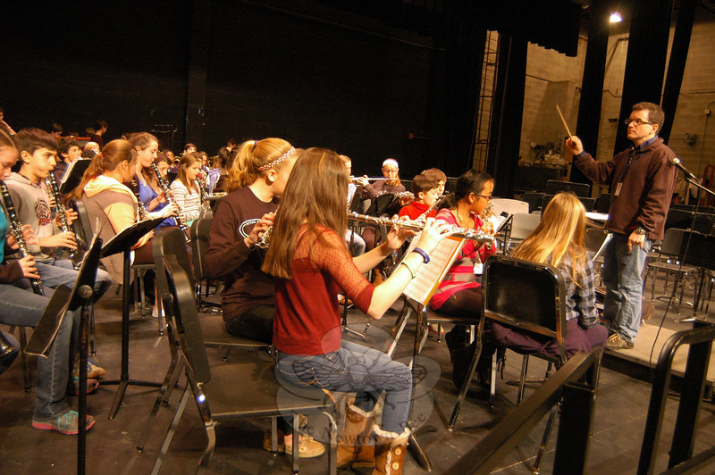 Newtown Middle School eighth grade band members rehearsed on Monday, December 16, under the guidance of NMS teacher Mark Mahoney. Members of the NMS eighth grade cho-rus and orchestras also rehearsed during the day at Newtown High School in preparation for the middle school's eighth grade concert that night. (Hallabeck photo)