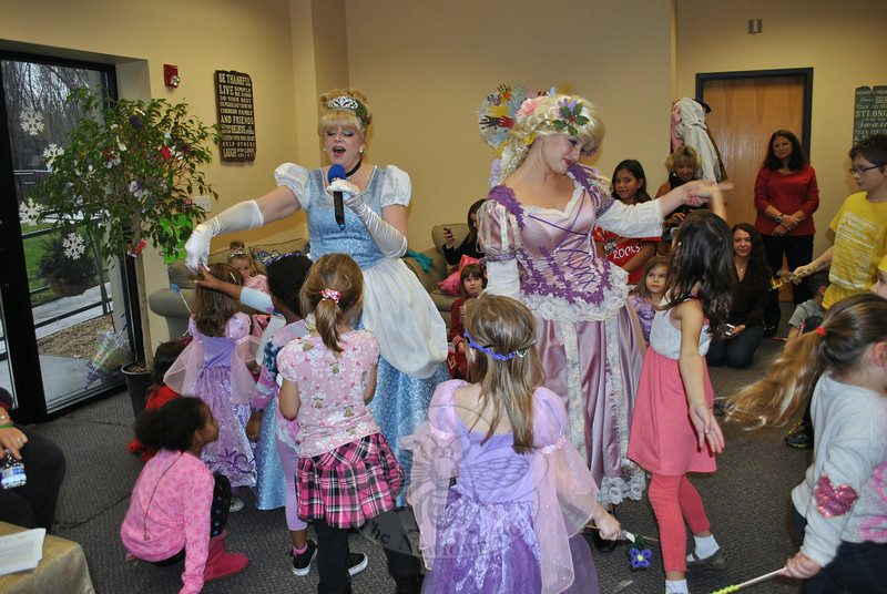 Cinderella (Kathryn Santillo) and Rapunzel (Samantha Phelan) lead the children in song and dance. (Crevier photo)