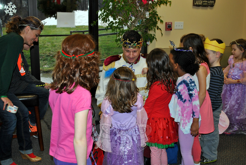 Prince Charming (Tim Santillo) of Invite A Princess greeted children at the Royal Party hosted by The Resiliency Center of Newtown on Monday, December 23.	(Crevier photo)