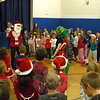 Middle Gate held its annual Winter Sing-Along on Friday, December 20. Music teacher Tina Jones led an assembly of students through singing a number of winter themed songs and the school's song. For one of the songs, Middle Gate Principal Christopher Geissler, stand-ing center left, snuck up behind Ms Jones, standing center right, in a Santa Claus T-shirt and disguise. (Hallabeck photo)