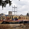 Construction crews work busily at the site of the new headquarters for Newtown Volunteer Ambulance Corps off Wasserman Way on the morning of December 26. This represents one of about a half-dozen significant capital projects the community will see either launching or taking shape in 2014.	(Voket photo)