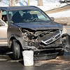 This Honda received front-end damage in a two-vehicle collision at the four-way intersec-tion of South Main Street and Borough Lane about 11:21 am on December 19. Police report that motorist Susan Kliczewski, 53, of 3 Borough Lane, who was driving a 2003 Honda CRV SUV, was stopped at a stop sign on the eastern section of Borough Lane and was waiting to drive across South Main Street to enter the western section of Borough Lane, as motorist Laura Vasile, 53, of Bethel was driving a 1999 Toyota Camry sedan southward on South Main Street. As the Honda attempted to cross South Main Street, the two vehicles collided, resulting in the Toyota then striking the masonry building of Amaral Motors Inc at 40 South Main Street, police said. The Toyota then spun around and struck a protective post near a gasoline pump. There were no injuries. Newtown Hook & Ladder volunteer firefighters and Newtown Volunteer Ambulance Corps members responded to the scene. Police said they issued Kliczewski an infraction for failure to grant the right of way at a stop sign. (Gorosko photo)
