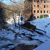 A trail in Rocky Glen State Park that starts at the end of Dayton Street in Sandy Hook Cen-ter quickly leads hikers to a rustic setting behind former factories along the Pootatuck  River. Now used as office space, the factories are located on Glen Road. (Bobowick photo)