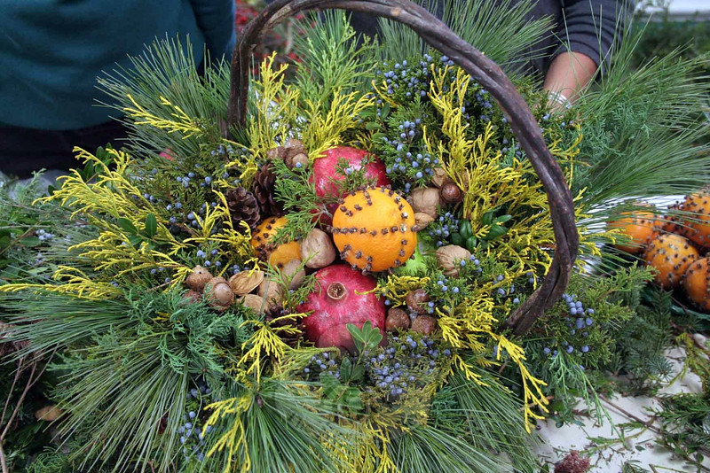After many years of closing up early because their inventory sold out, The Garden Club of Newtown will formally end this year's Greens Sale at noon on December 7. Members participated in workshops to put the final touches on fresh wreaths, baskets, and other holiday decorations. These ladies were all at the December 4 workshop at Newtown Meeting House. (Hicks photo)