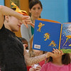 Students read along to Giles Andreae's book Giraffes Can't Dance during a presentation by representatives of the Joffrey Ballet School. (Hallabeck photo)