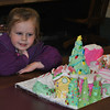 Three-year-old Ava Pokladowski is mesmerized by the gingerbread Whoville scene from How The Grinch Stole Christmas, an entry that won Girl Scout Troop 50040 first prize in the Youth division of the Gingerbread House Contest. (Crevier photo)