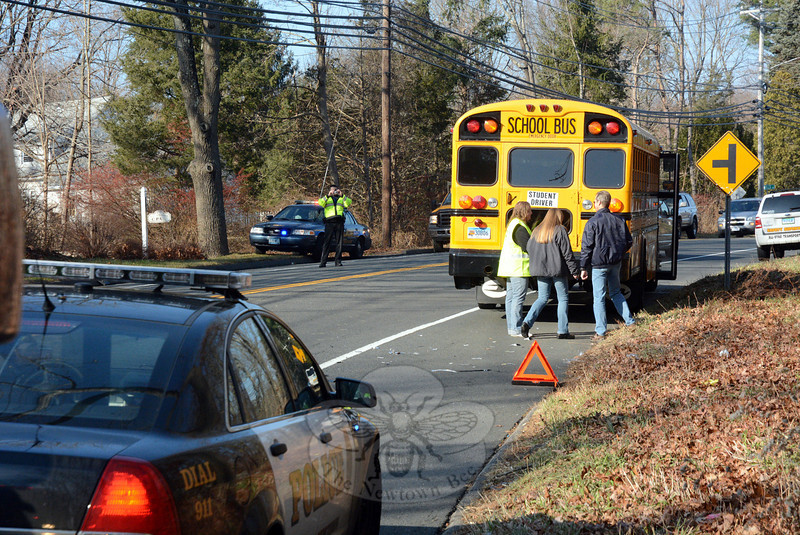 This school bus, which was not carrying school children, was one of three vehicles involved in an acci-dent about 11 am on December 4 at the intersection of South Main Street and Orchard Hill Road. Police said that school bus driver Claribel Nunez, 31, of Danbury was driving the All-Star Transportation bus northward on South Main Street, when eastbound motorist Robert Abram, 76, of 19 Castle Meadow Road, who was driving a 2008 Hyundai Elantra sedan, went past a stop sign on Orchard Hill Road and struck the left side of the bus. The Hyundai then spun around from the impact and struck a southbound 2009 Subaru Legacy sedan driven by Jose Machado, 31, of Waterbury, police said. Newtown ambulance volunteers transported Machado to Danbury Hospital to be checked for shoulder pain, police said. Botsford firefighters responded to the accident. Police said they charged Abram with failure to obey a stop sign and with driving with a suspended license. Abram was released on a written promise to appear in court on December 18. (Gorosko photo)