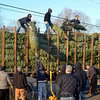 Volunteers and family members answered the call to help unload November 29 as a truckload of holiday trees arrived for the Sandy Hook Fire & Rescue benefit tree sale. The annual activity, this year chaired by company members Michael and Kelly Burton, will extend daily from 9 am to 9 pm through the holiday season — or until all the trees are gone. A  truckload of various fresh-cut trees will be available for sale at the station while supplies last. (Voket photo)